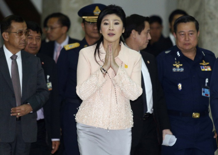 Thailand's Prime Minister Yingluck Shinawatra gestures while speaking to reporters following following the declaration of a state of emergency in Bangkok January 21, 2014. The Thai government on Tuesday declared a 60-day state of emergency to start on Wednesday, saying it wanted to prevent any escalation in more than two months of protests aimed at forcing Prime Minister Yingluck Shinawatra from power. (Athit Perawongmetha/Reuters)