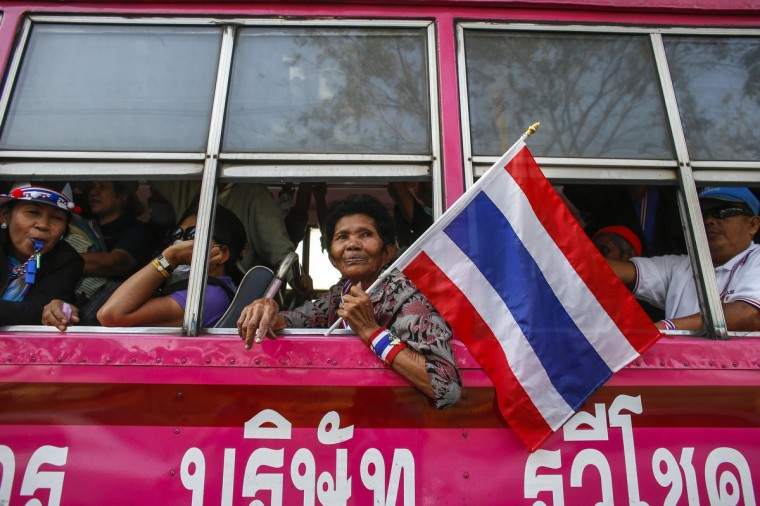 Anti-government protesters leave the Thai Royal Police Club in a bus during a rally in Bangkok. Thailand's government will deploy 10,000 police in the capital for Sunday's election, which protesters have promised to disrupt as part of their drawn-out attempt to topple Prime Minister Yingluck Shinawatra. (Athit Perawongmetha/Reuters)
