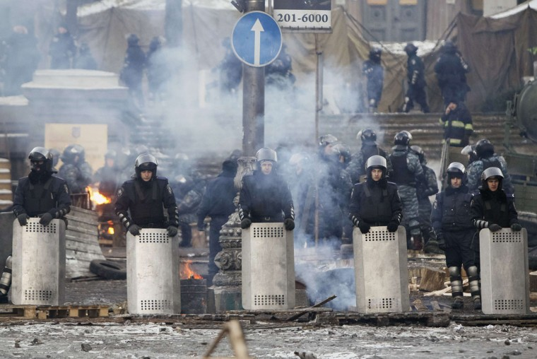 Riot police stand in formation facing anti-government protesters in Kiev, January 31, 2014. Ukraine's embattled President Viktor Yanukovich on Friday signed into law an amnesty for demonstrators detained during mass unrest and repealed anti-protest legislation, in a fresh bid to take the heat out of the political crisis. (REUTERS/Gleb Garanich)