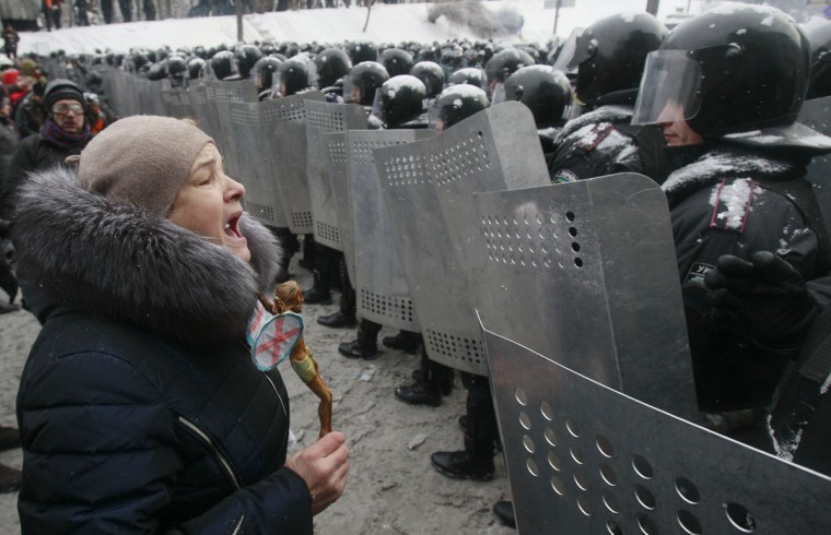 "A woman addresses Ukrainian Interior Ministry members who lined up during clashes with pro-European protesters in Kiev January 22, 2014. Ukrainian Prime Minister Mykola Azarov said on Wednesday anti-government protests had brought ""terrorists"" on to the streets and warned that all ""criminal actions"" would be punished. (REUTERS/Gleb Garanich)"