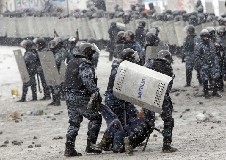 "Riot police officers hold a man during clashes with pro-European protesters in Kiev January 22, 2014. Ukraine's prime minister denounced anti-government protesters as ""terrorists"" on Wednesday, but in what appeared to be his first real move to end weeks of unrest President Viktor Yanukovich held talks with opposition leaders. (REUTERS/Gleb Garanich)"