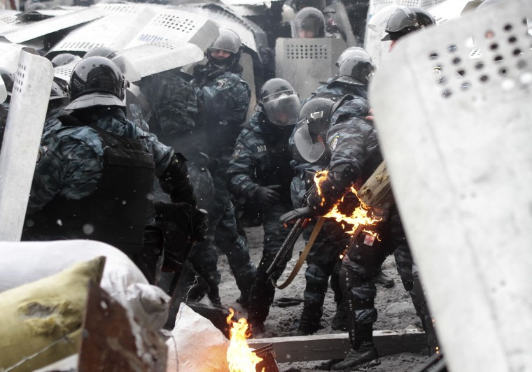 "A riot police officer's uniform catches fire during clashes with pro-European protesters in Kiev January 22, 2014. Ukraine's prime minister denounced anti-government protesters as ""terrorists"" on Wednesday, but in what appeared to be his first real move to end weeks of unrest President Viktor Yanukovich held talks with opposition leaders. (REUTERS/Stringer)"