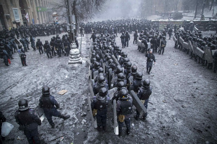 "Riot police and Interior Ministry members stand in formation during clashes with pro-European protesters in Kiev January 22, 2014. Ukraine's prime minister denounced anti-government protesters as ""terrorists"" on Wednesday, but in what appeared to be his first real move to end weeks of unrest President Viktor Yanukovich held talks with opposition leaders. (REUTERS/Stringer)"