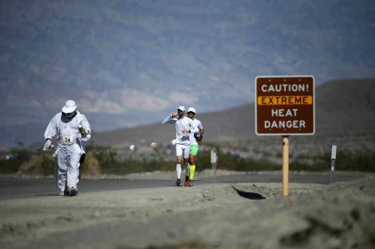 Badwater: A scene from the 135-mile Badwater Ultramarathon in Death Valley National Park, California in this file photo taken July 15, 2013. The Badwater Ultramarathon normally takes place in July. (REUTERS/Lucy Nicholson)