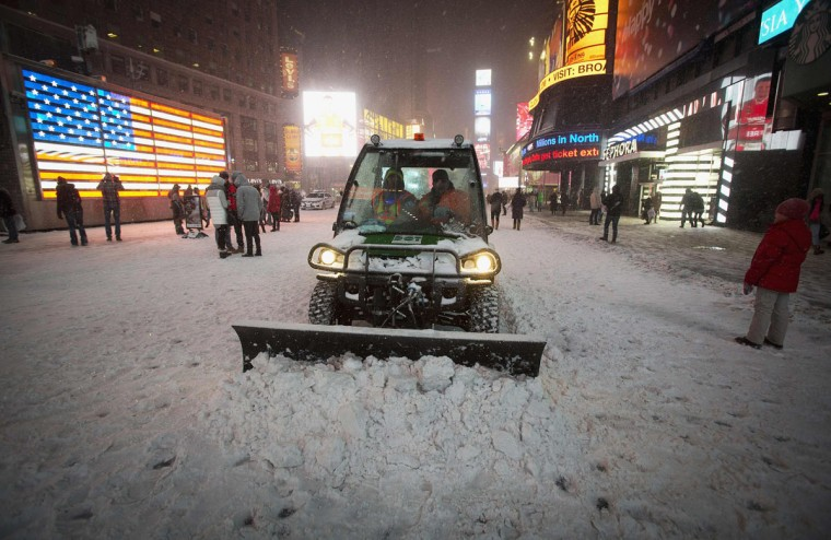 A snow plow pushes snow through Times Square in New York on January 3, 2014. (REUTERS/Carlo Allegri)