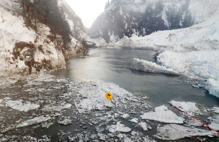 The Richardson Highway is pictured in this January 25, 2014 handout photo as it runs through the Keystone Canyon in the aftermath of a January 24 avalanche that closed the highway near Valdez, Alaska. Road traffic to Valdez was cut off from the rest of the state after a series of avalanches over the weekend blocked the only road into the coastal community. As of January 31, 6 miles (10 km) of the highway remained closed, according to the Alaska Department of Transportation and Public Utilities (Alaska DOT&PF). REUTERS/Alaska DOT&PF/Handout via Reuters)
