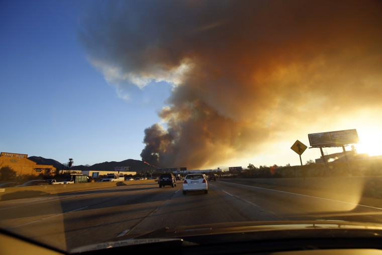 Smoke rises from the Colby Fire seen from the Foothill Freeway approaching Glendora, California January 16, 2014. The fire began early Thursday morning and has so far scorched 125 acres. (REUTERS/Mario Anzuoni)