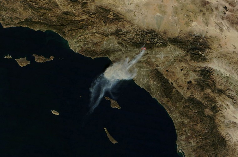 A fast-moving wildfire called Colby Fire is seen in a NASA satellite image captured just after 12:00 PM local time (20:00 GMT) in this January 16, 2014 picture provided by NASA. The wind-whipped blaze erupted before dawn in the Angeles National Forest north of Glendora, about 40 miles (60 km) east of downtown Los Angeles in the foothills of the San Gabriel Mountains. (REUTERS/NASA)