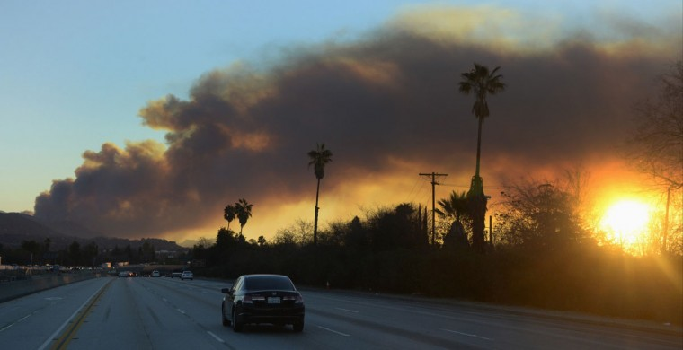 "Thick smoke fills the morning skies as firefighters battle a fast-moving California wildfire, so-called the ""Colby Fire"", in the hills of Glendora January 16, 2014. The wildfire, started accidentally by three campers, roared out of control in foothills above Los Angeles on Thursday, destroying at least two homes and forcing more than 1,000 residents to flee, fire and law enforcement officials said. The wind-whipped blaze erupted before dawn in the Angeles National Forest north of Glendora, about 40 miles east of downtown Los Angeles in the foothills of the San Gabriel Mountains. (REUTERS/Gene Blevins)"