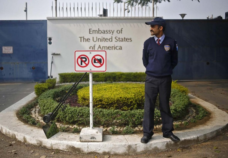 Diplomatic drama: A private security guard stands outside the U.S. embassy in New Delhi in December. As part of an ongoing diplomatic dispute, India has told the embassy to cease several commercial activities, The Times of India reports. (Anindito Mukherjee/Reuters)