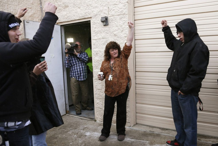 Cheri Hackett, center, co-owner of the Botana Care marijuana store, celebrates just before opening her doors to customers for the first time in Northglenn, Colo. on Jan. 1, 2014. (Rick Wilking/Reuters)