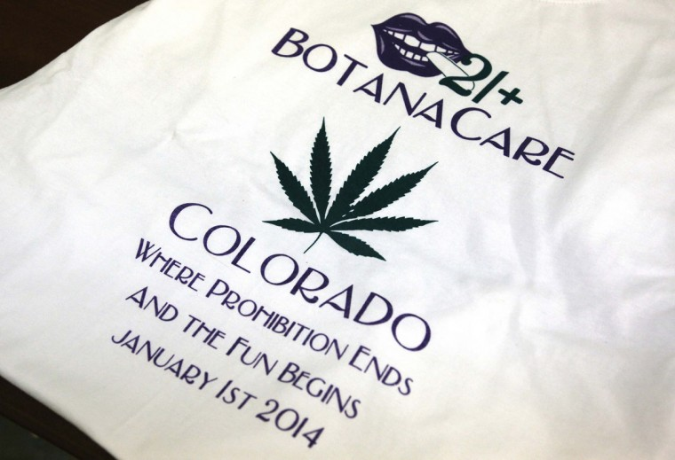 A commemorative T-shirt is displayed for sale at the Botana Care marijuana store just before opening the doors to customers for the first time in Northglenn, Colo., on Jan. 1, 2014. (Rick Wilking/Reuters)