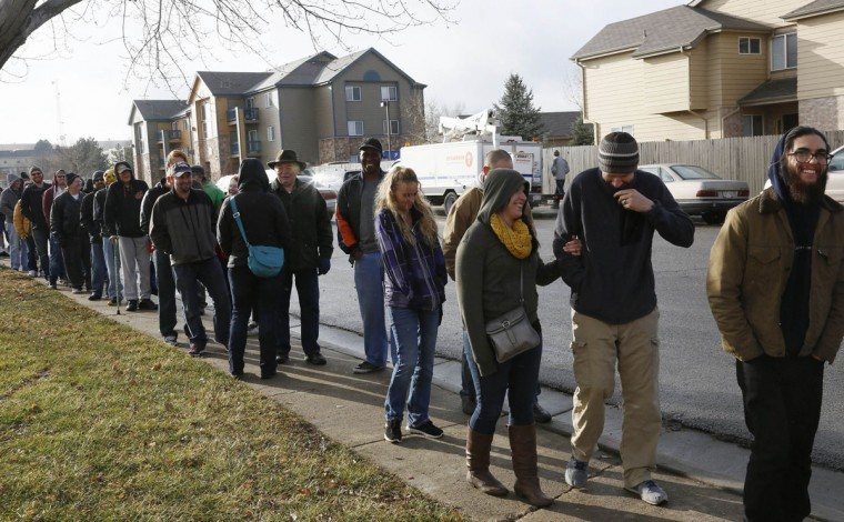 People wait in line to be among the first to legally buy recreational marijuana at the Botana Care store in Northglenn, Colo. on Jan. 1, 2014. (Rick Wilking/Reuters)