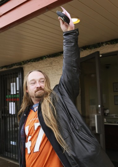 Jesse Phillips celebrates being the first person to legally buy recreational marijuana at the Botana Care store in Northglenn, Colo., on Jan. 1, 2014. (Rick Wilking/Reuters)
