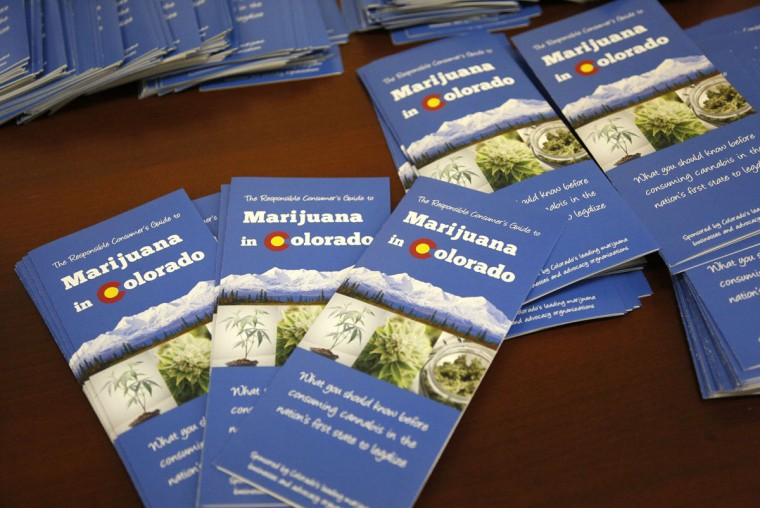 Informational brochures are prepared for the Botana Care marijuana store opening on New Year's Day in Northglenn, Colo. (Rick Wilking/Reuters)