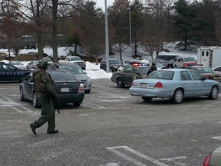 A police officer is seen at mall in Columbia, Maryland, January 25, 2014. Three people died in a shooting at a large shopping center outside of Baltimore, Maryland, on Saturday, and police said they were allowing shoppers to leave the mall after determining there was no longer a threat. (REUTERS/DCMediagroup/Robert Brune)