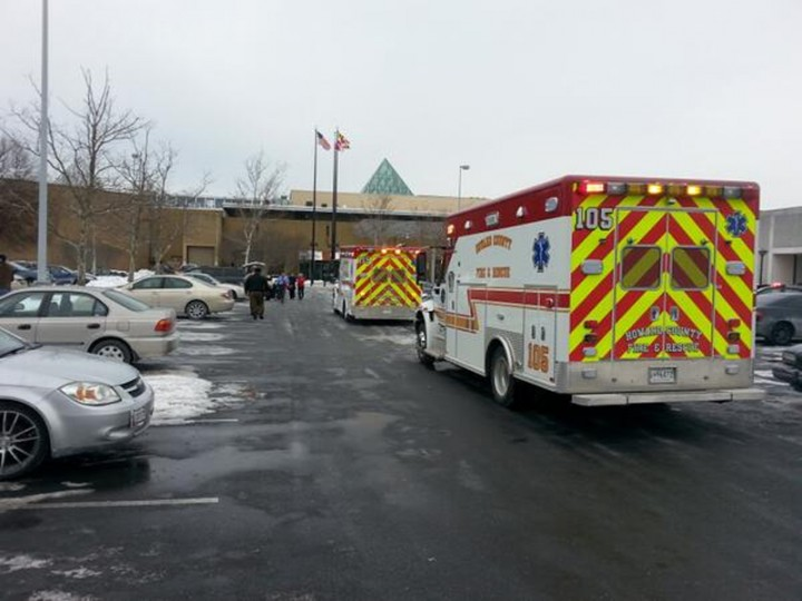 Emergency vehicles are seen at mall in Columbia, Maryland, January 25, 2014. Three people died in a shooting at a large shopping center outside of Baltimore, Maryland, on Saturday, and police said they were allowing shoppers to leave the mall after determining there was no longer a threat. (REUTERS/DC Mediagroup/Robert Brune)