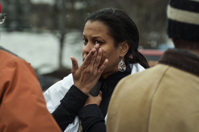 Tarah William of Lanham, Maryland reacts after she was evacuated from a building following a shooting at a shopping mall in Columbia, Maryland January 25, 2014. Three people died in a shooting at a large shopping mall outside of Baltimore, Maryland, on Saturday, and one of the dead was believed to be the shooter, police said. (REUTERS/James Lawler Duggan)