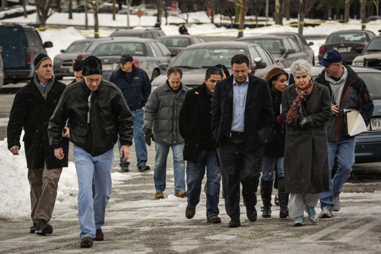 Howard County officials walk to deliver remarks after a shooting at a shopping mall in Columbia, Maryland January 25, 2014. Three people died in a shooting at a large shopping mall outside of Baltimore, Maryland, on Saturday, and one of the dead was believed to be the shooter, police said. (REUTERS/James Lawler Duggan)