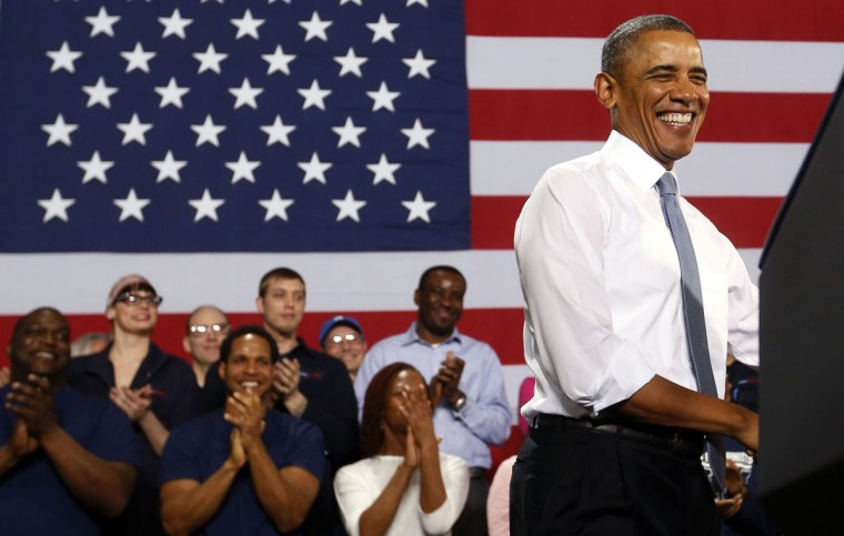 U.S. President Barack Obama smiles before he addresses employees of General Electric's Waukesha Gas Engines facility in Waukesha, Wisconsin, January 30, 2014. REUTERS/Larry Downing
