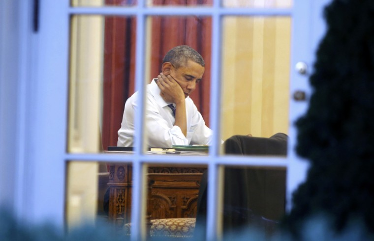 U.S. President Barack Obama sits inside the Oval Office as he prepares for Tuesday night's State of the Union Address to the nation on Capitol Hill, while at the White House in Washington, January 27, 2014. (Larry Downing/Reuters)