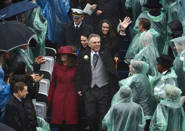 Terry McAuliffe waves to guests as he arrives in rainy weather with wife Dorothy and family for his swearing-in ceremony as Virginia's governor in Richmond, Virginia, January 11, 2014. McAuliffe, 56, a former chairman of the Democratic National Committee and a major party fundraiser, narrowly defeated Republican Ken Cuccinelli, the outgoing attorney general. The ceremony marks the first time in a quarter-century that Democrats will hold all three of the state's top elective posts: governor, lieutenant governor and attorney general. (REUTERS/Mike Theiler)