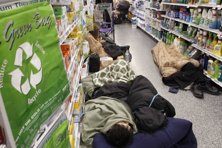 People sleep at the aisle of a Publix grocery store after being stranded due to a snow storm in Atlanta, Georgia, January 29, 2014. A rare winter storm gripped the U.S. South on Wednesday, killing five people, stranding children overnight at their schools, gnarling traffic across many states and canceling flights at the world's busiest airport. (Tami Chappell/Reuters)