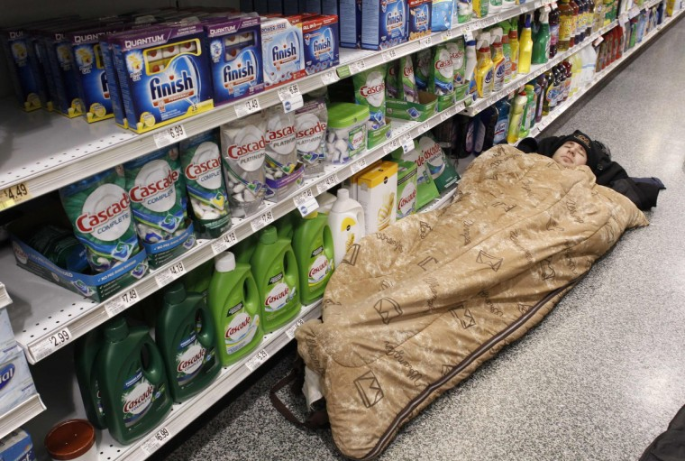 Kienan Dietrich sleeps at the aisle of a Publix grocery store after being stranded due to a snow storm in Atlanta, Georgia, January 29, 2014. A rare winter storm gripped the U.S. South on Wednesday, killing five people, stranding children overnight at their schools, gnarling traffic across many states and canceling flights at the world's busiest airport. (Tami Chappell/Reuters)