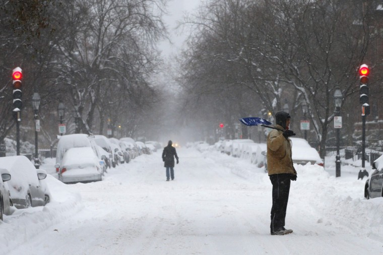 A shoveler stands on Marlborough Street during a winter nor'easter snow storm in Boston on January 3, 2014. (REUTERS/Brian Snyder)