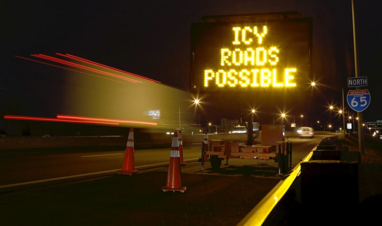A travel warning sign is seen along Interstate 65 as cold weather descends on Mobile, Ala. (REUTERS/Lyle Ratliff)