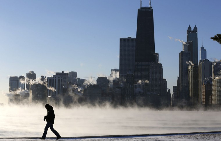 A man is silhouetted against the arctic sea smoke rising off Lake Michigan in Chicago. (REUTERS/Jim Young)