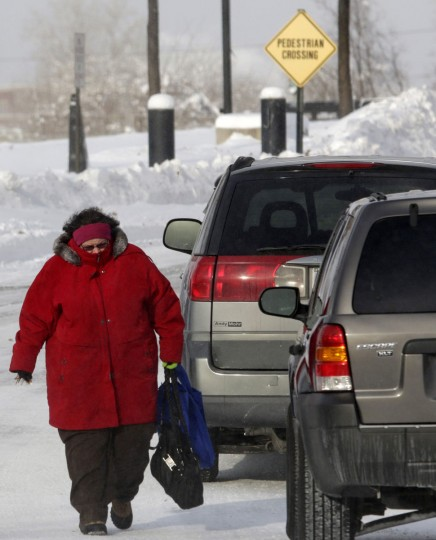 A woman is bundled up against the cold weather in Indianapolis. (REUTERS/Nate Chute)