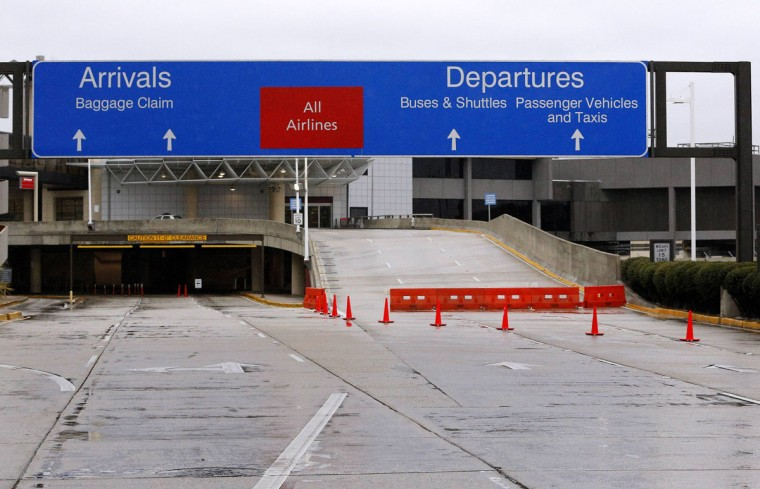 A barrier blocks the entrance to departures at the Louis Armstrong International Airport in Kenner, La. (REUTERS/Jonathan Bachman)
