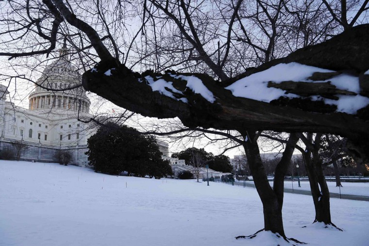 Snow covers the U.S. Capitol grounds in Washington January 22, 2014. The northeastern United States on Wednesday dug out from a storm that dumped over a foot of snow in many places with frigid, windy weather keeping some schools and offices closed and flights canceled. (REUTERS/Jonathan Ernst)