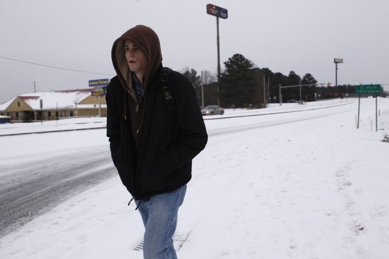 Chris Campbell, a student at Kennesaw College, walks home leaving his car stranded after a rare snowstorm in Kennesaw, Ga. (REUTERS/Tami Chappell)