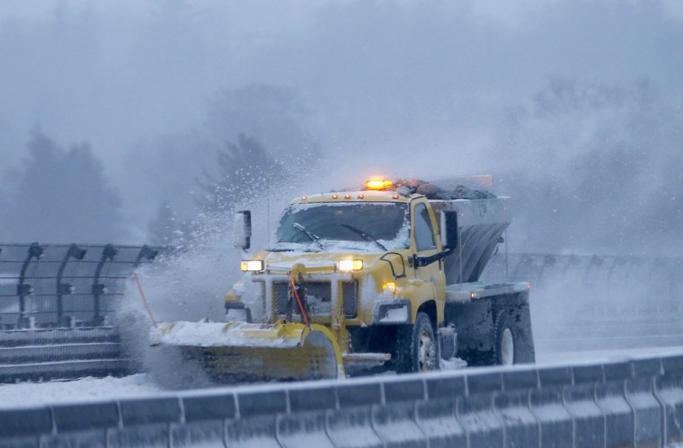 A snow plow clears the road of snow along the New York State Thruway Interstate 87 in Tarrytown, New York on January 3, 2014. (REUTERS/Mike Segar)