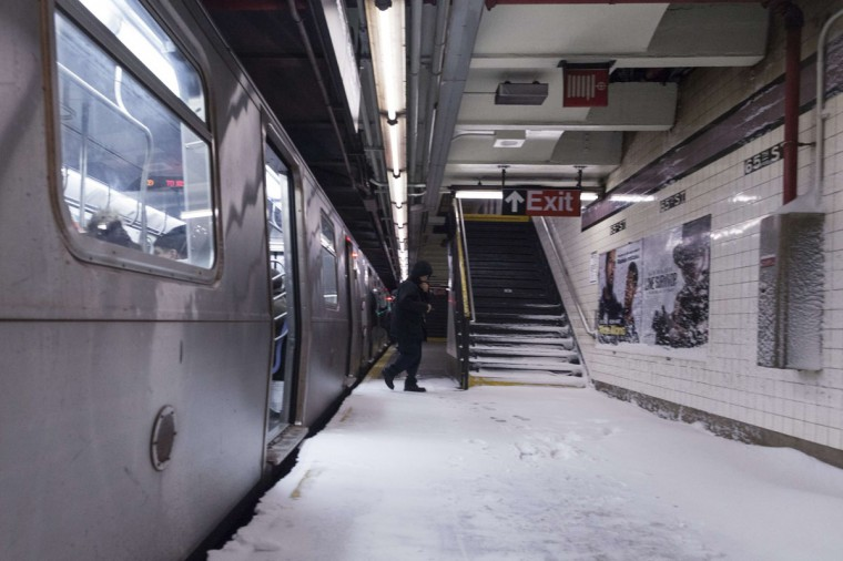 Snow makes it way down to the platform of the 65th Street subway station during a winter storm in New York on January 3, 2014. (REUTERS/Zoran Milich)