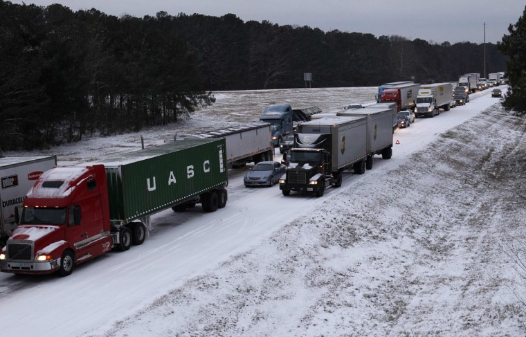 Cars and trucks are gridlocked on the I-75 interstate highway after a rare snowstorm in Kennesaw, Ga. (REUTERS/Tami Chappell)