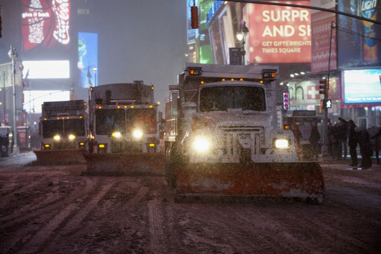 New York City plow trucks clear the streets of Times Square during snow fall in Midtown on January 2, 2014. (REUTERS/Darren Ornitz)