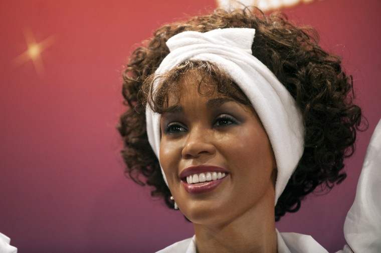One of four wax figures of deceased singer Whitney Houston sits on display after being unveiled at Madame Tussauds Wax Museum in New York, February 7, 2013. One of each of the four figures will be put on display at the museums in New York, Washington, D.C., Hollywood, and Las Vegas. It is the first time the museum has simultaneously produced multiple likenesses of a single subject. (Keith Bedford/Reuters)