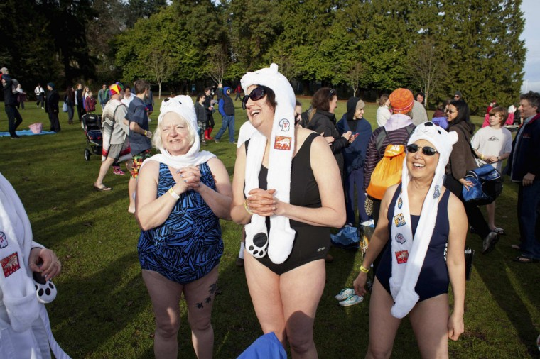 From left, Kathy Ringo, Beth Hartman, and B.T. Eberhart are pictured before entering Lake Washington during the 12th annual Polar Bear Plunge in Seattle, on January 1, 2014. Hundreds participated in the chilly New Year's Day tradition, organized by Seattle Parks and Recreation and held at Matthews Beach. (REUTERS/David Ryder)