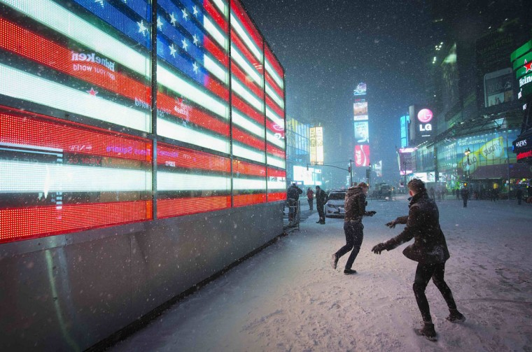 People have a snowball fight in Times Square in New York on January 3, 2014. (REUTERS/Carlo Allegri)