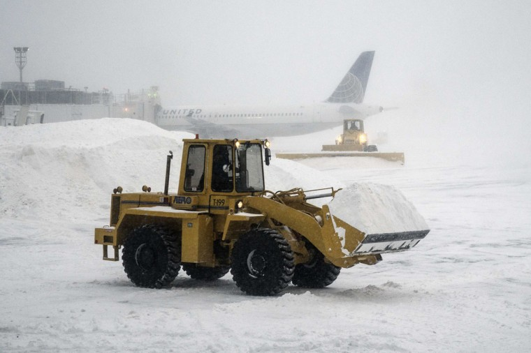 Heavy machinery clears the snow at LaGuardia Airport during a winter storm in New York on January 3, 2014. (REUTERS/Zoran Milich)