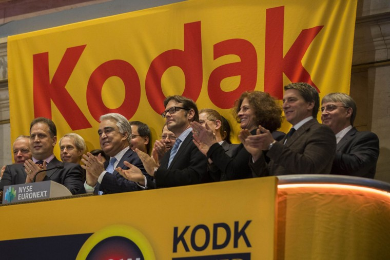 Antonio Perez (4th L), CEO of Eastman Kodak Company, applauds after ringing the opening bell on the floor of the New York Stock Exchange in the Manhattan borough of New York January 8, 2014. (REUTERS/Lucas Jackson)
