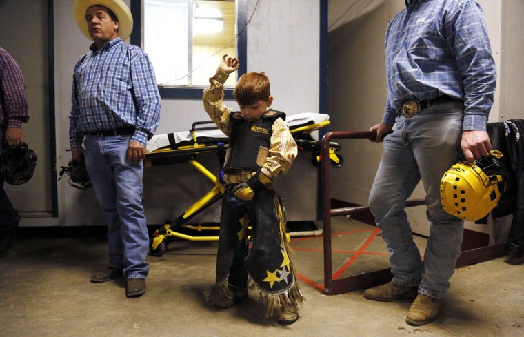 Avery Speck, 8, practices holding on before competing in the mini bull riding competition at the 108th National Western Stock Show in Denver January 11, 2014. The show, which features more than 15,000 head of livestock, opened on Saturday and runs through January 26. (REUTERS/Rick Wilking)