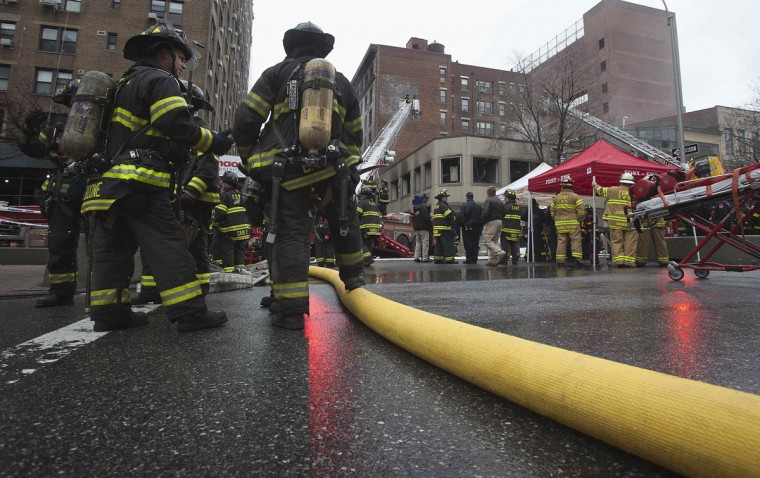 Firefighters work on a five-alarm blaze on the Upper East Side of Manhattan in New York January 11, 2014. (REUTERS/Carlo Allegri)
