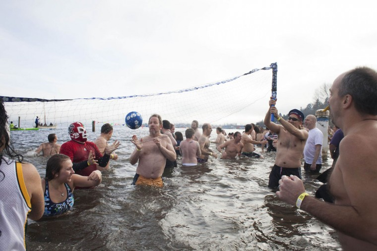 People play volleyball in Lake Washington during the 12th annual Polar Bear Plunge in Seattle on January 1, 2014. Hundreds participated in the chilly New Year's Day tradition, organized by Seattle Parks and Recreation and held at Matthews Beach. (REUTERS/David Ryder)