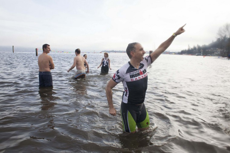 A man celebrates after entering Lake Washington during the 12th annual Polar Bear Plunge in Seattle on January 1, 2014. Hundreds participated in the chilly New Year's Day tradition, organized by Seattle Parks and Recreation and held at Matthews Beach. (REUTERS/David Ryder)