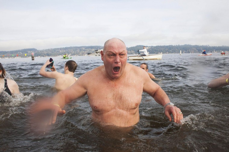 A man reacts after entering Lake Washington during the 12th annual Polar Bear Plunge in Seattle on January 1, 2014. Hundreds participated in the chilly New Year's Day tradition, organized by Seattle Parks and Recreation and held at Matthews Beach. (REUTERS/David Ryder)