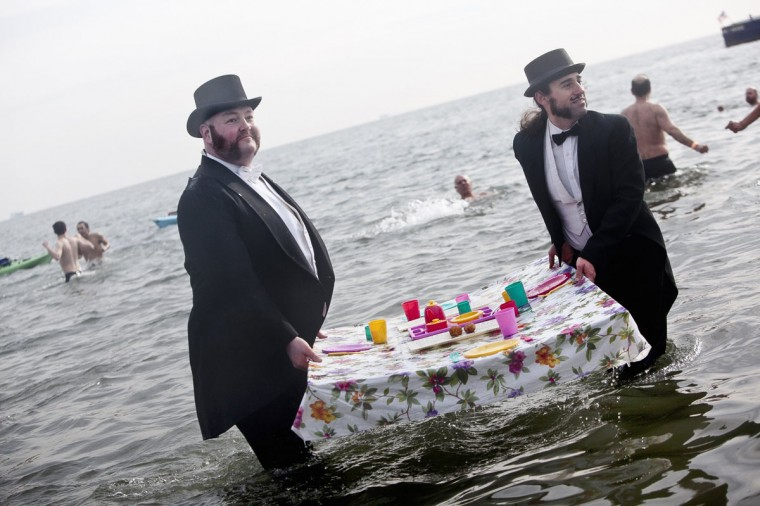 People in suits participate in the annual Coney Island Polar Bear Club dip, in the Brooklyn borough of New York on January 1, 2014. The Coney Island Polar Bear Club is the oldest winter bathing organization in the U.S. and every New Year's Day holds the winter plunge, which attracts thousands of participants. (REUTERS/Allison Joyce)